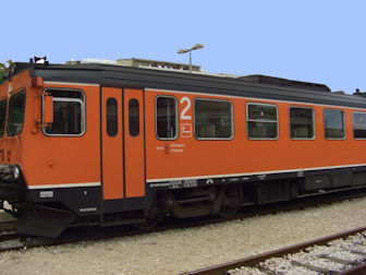 Orange train in station