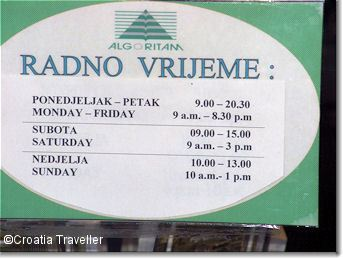 Sign showing working hours